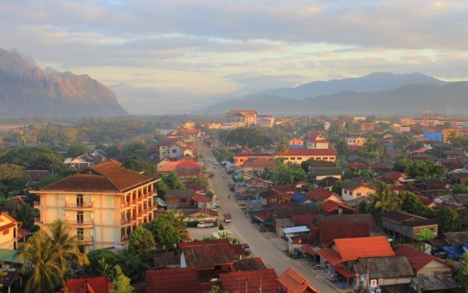 Streets of Vang Vien from hot air balloon during sunrise.