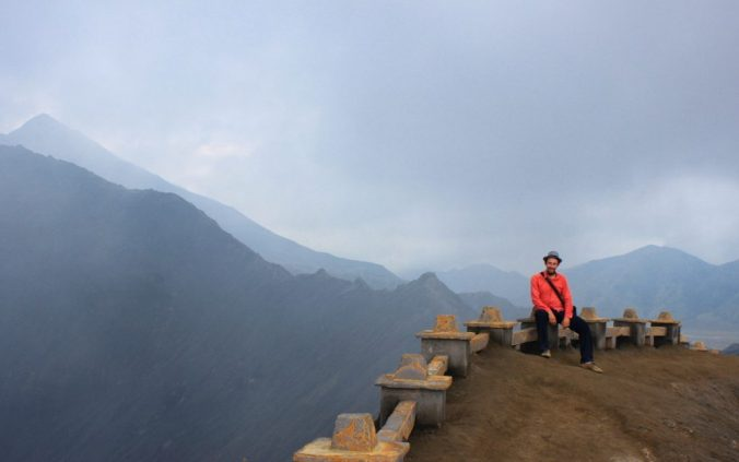 Sitting at the edge of the crater.