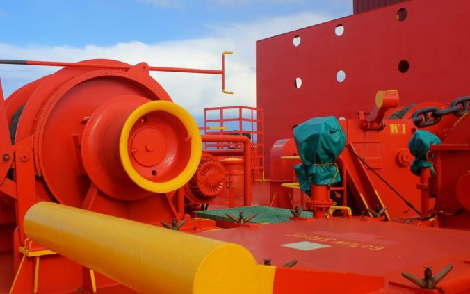 Red structures on the front of a cargo ship.
