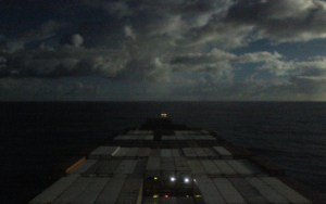 Crossing the Pacific on a cargo ship during the night.