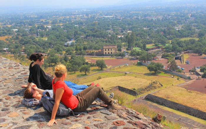 Resting at the top of the Pyramid of the Sun. Visiting Teotihuacan without a tour.