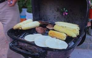 Mexican tortillas and corn on a grill.