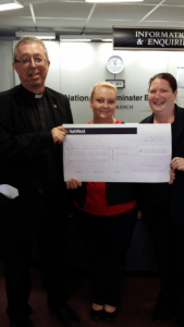 Staff from Natwest Fleet Branch who have collected £715 from customers