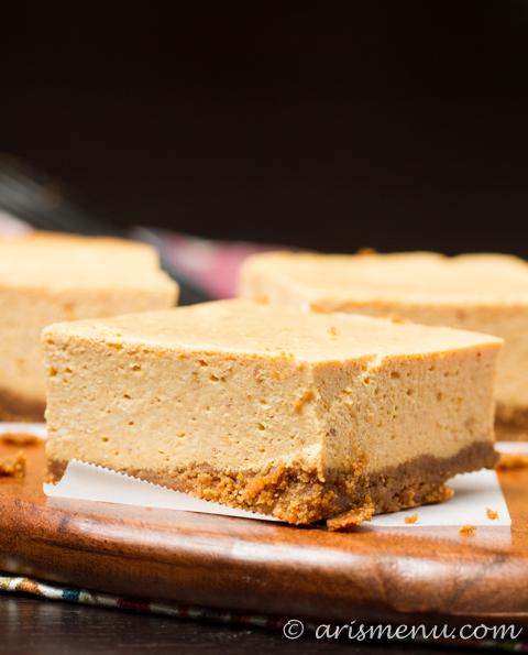 Pumpkin Cheesecake Bars: Ultra silky pumpkin cheesecake with a gingersnap crust. My family's favorite Thanksgiving dessert!