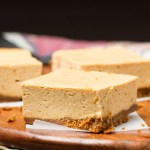 Pumpkin Cheesecake Bars: Ultra silky pumpkin cheesecake with a gingersnap crust. My family's favorite Thanksgiving dessert!