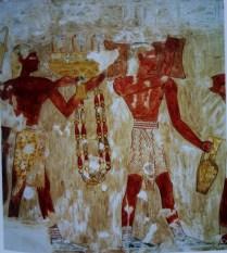 Άνδρες με χαρακτηριστικά Μινωικά περιζώματα προσφέρουν πολύτιμα είδη (χαλκό, αγγεία, κοσμήματα) στην Αιγυπτιακή αυλή.