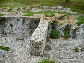 House foundations and walls on the Pnyx, hewn out of the native rock.