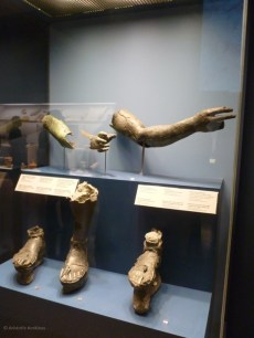 Bronze members belonging to several unrecovered statues.