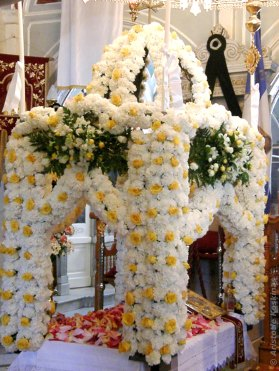 """Epitaphios"" decorated with flowers in a Greek Orthodox church."