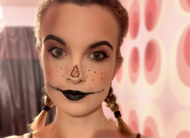 Scarecrow Makeup with pigtails and pink background