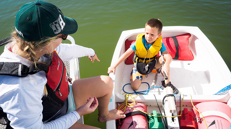 A little personal coaching from the safety boat on Tempe Town Lake. Photo: Mike Ferring