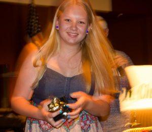 Emma Davis picks up a juniors trophy.