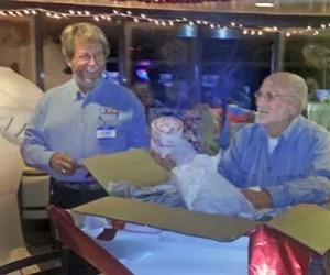Tom Errickson and Gene Walentiny unearthing a gift. Photo: Emory Heisler
