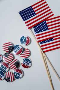 Buttons of Vote and American flags and small American flags