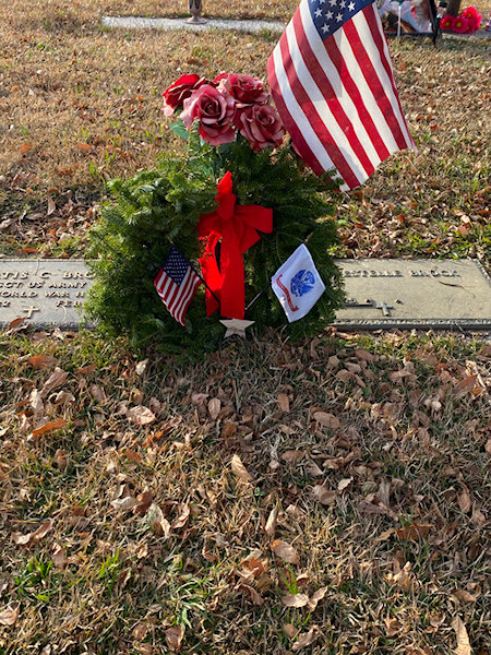 Wreath at grave for Wreaths Across America
