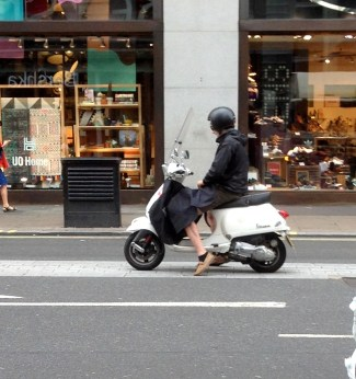 Shortly before this was taken the rider was looking her her phone. Texting? Chasing Pokemons?