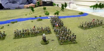 The Confederates move first. Cavalry gallops in a cloud of dust to take the western ford.