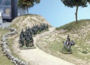 95th Rifles on the Dusty Road. Some bossy fellow points the way.