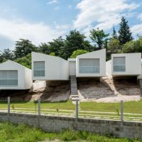 Carlos Alejandro Ciravegna - Five houses suspended over a rocky hill