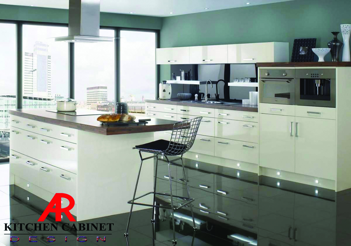 A modular kitchen design by AR Kitchen Cabinet. The side of the room is complete with appliances.