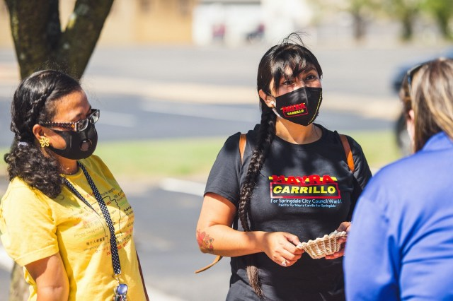 Mayra Carrillo, candidate for Ward 1, Position 2, speaks to voters at an event in Springdale.