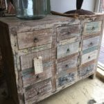 Reclaimed hardwood vintage style 12 drawer chest of drawers.