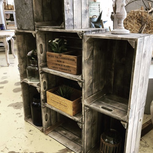Crates from reclaimed wood stacked as display unit Camberley Surrey vintage store
