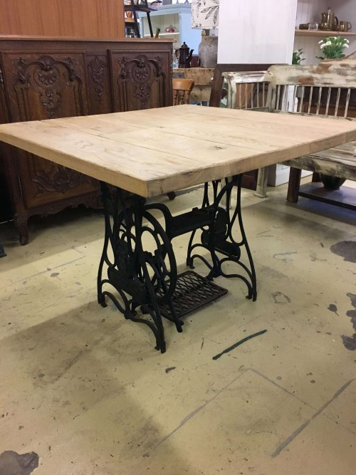 Table from old vintage French cast iron sewing base, with a reclaimed oak top.