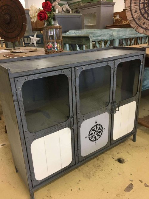 Industrial metal cabinet, with stencilled panels and glass in the doors.