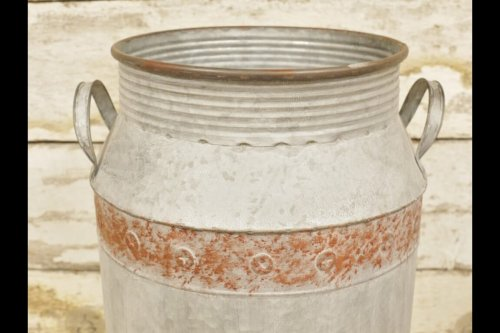 Vintage Style Metal Churns from arkvintage these vintage style metal churns have a charming look and patina. garden planters metal churn