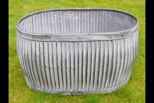 Galvanised Metal Planter Tubs Oval vintage industrial online buy shop camberley surrey from arkvintage. Classic ribbed planters in galvanised metal. Fabulous vintage look for your garden trees, plants or herbs etc. Available online now in 3 sizes.