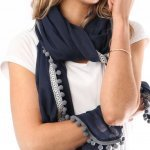 Scarf Aztec Trim With Pom Poms msh at ark vintage. A navy blue scarf with an Aztec trim and little grey pom poms round the edges. Sophisticated, smart and with a hint of fun that shows the rebel in you. Buy online or in store, Camberley Surrey.