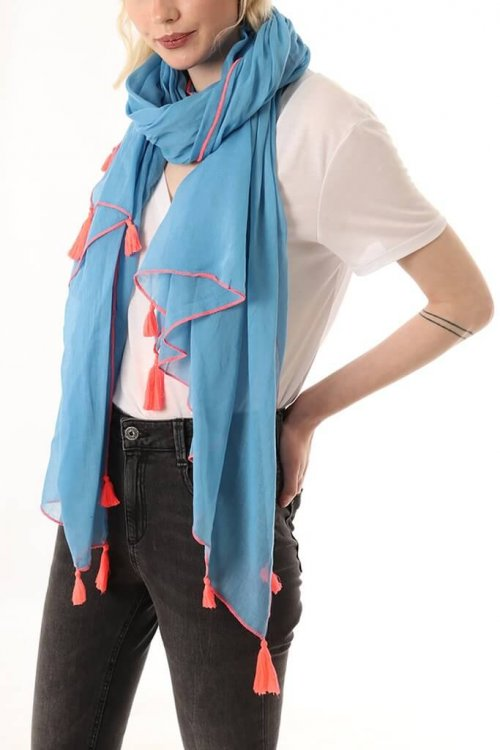 Scarf With Tassels at ark vintage. A plain cotton scarf with a tassel detail at each corner. This lightweight design can also be worn alternatively as a sarong. Available in 2 colours: blue with a neon coral stitching and grey with neon yellow stitching.