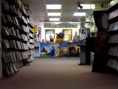An employee sorts through returned DVDs on the final day of regular operation of Video Horizons. The store will officially close after a liquidation sale March 31, 2011. March 13, 2011.