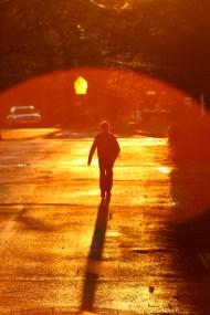 A child walks to school up Hemlock Street the week before Winter Vacation. December 22, 2011.