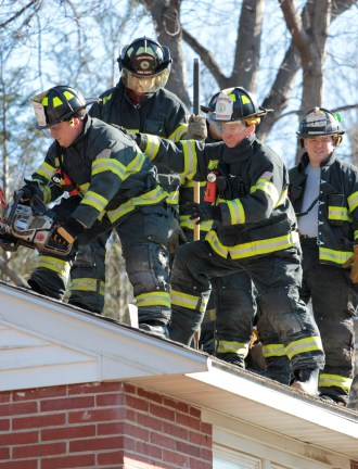 Arlington firefighters run a training exercise on an Epping street home scheduled for demolition. February 10, 2012.