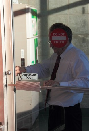 A manager at Johnnie's Foodmaster locks the front door after the last-ever customer has left. November 18, 2012.