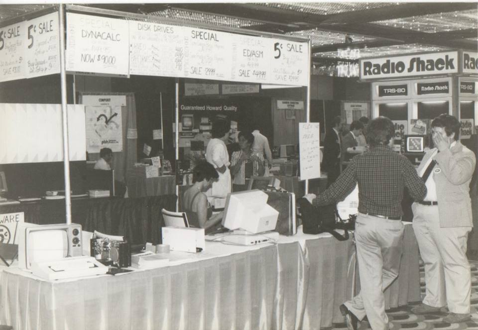 """Another booth. According to Frank Hogg, """"Carol Sprague in the booth, Bob Phillips from GMX talking to Rich Hogg."""""""