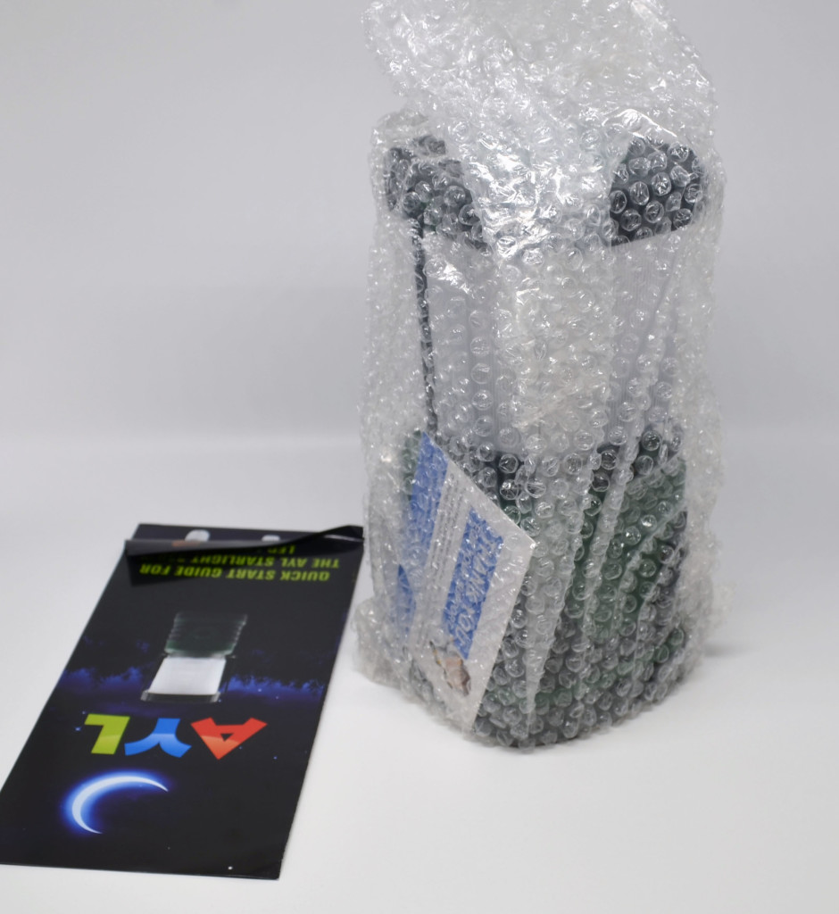 AYL StarLight 330 LED camping lantern packaging contents, a manual and the lantern.