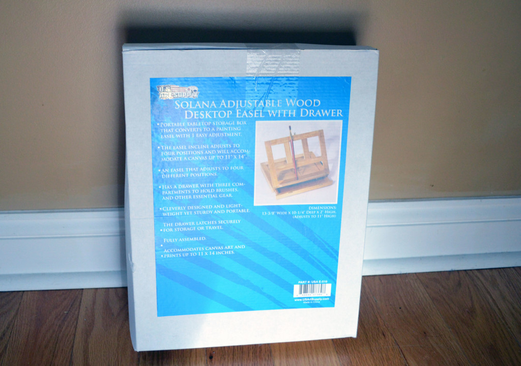 The packaging for Solana Adjustable Wood Desk Easel with Drawers.