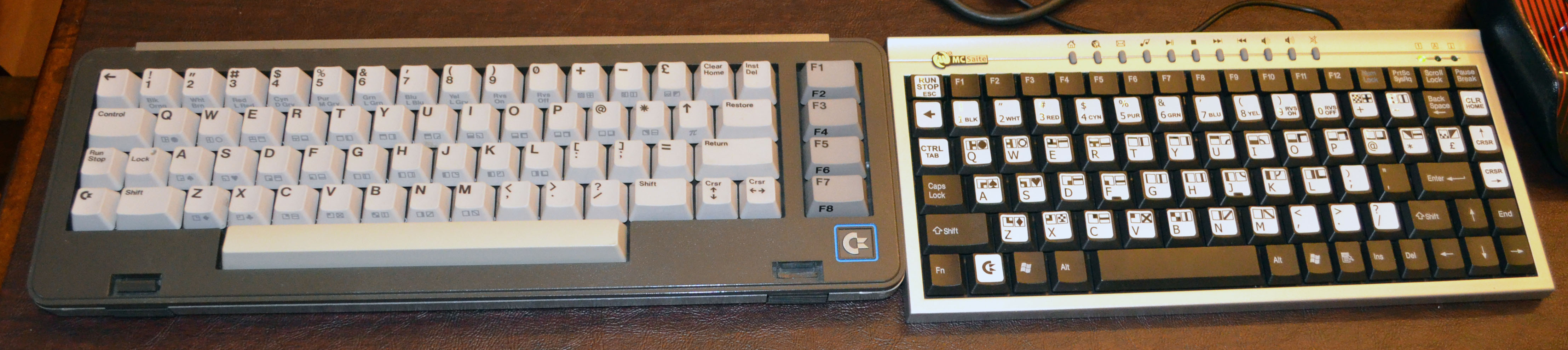 The original SX-64 keyboard (left) and my cheap sticker keyboard (right).