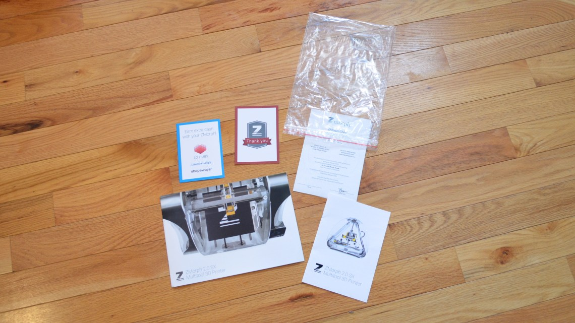The remaining materials in the plastic zip bag include a catalog, warranty card, and other miscellaneous paperwork.