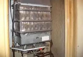 Asbestos refurbishment and demolition survey - Asbestos panelling inside heater cupboard