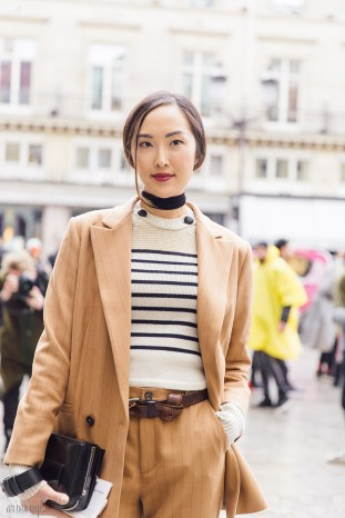 Chriselle Lim in stripped shirt and brown pantsuit at Paris Fashion Week photo by Armenyl.com