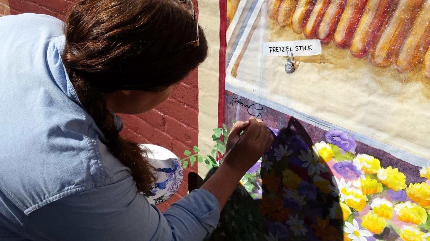 signing mural