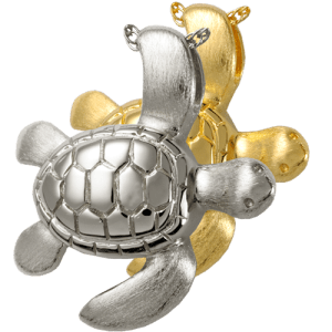 Turtle pendant shown in gold plated and sterling silver. Engraved with lines on shells and facial features.
