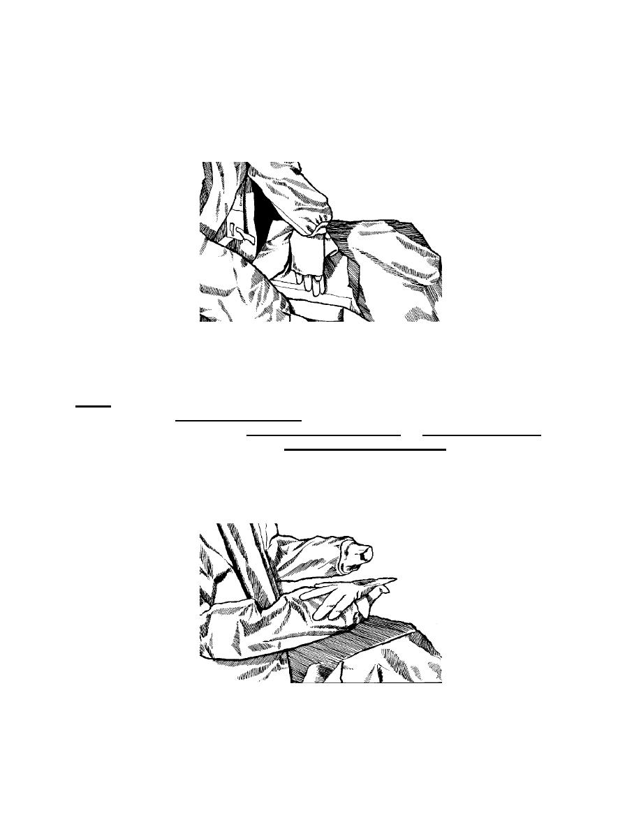 Figure 1-21. Picking up a glove by its folded cuff edge