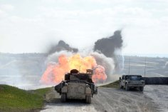 soldiers explode the way through a training mine field with a mine-clearing line charge.