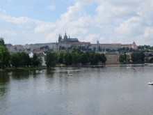 Looking at the Prague Castle behind the Vltava River and the Charles Bridge