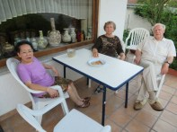 Hanh, Kathy, and Peter at their patio table